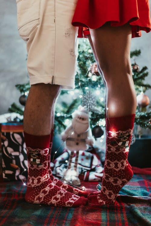 Couple Wearing Red Christmas Socks