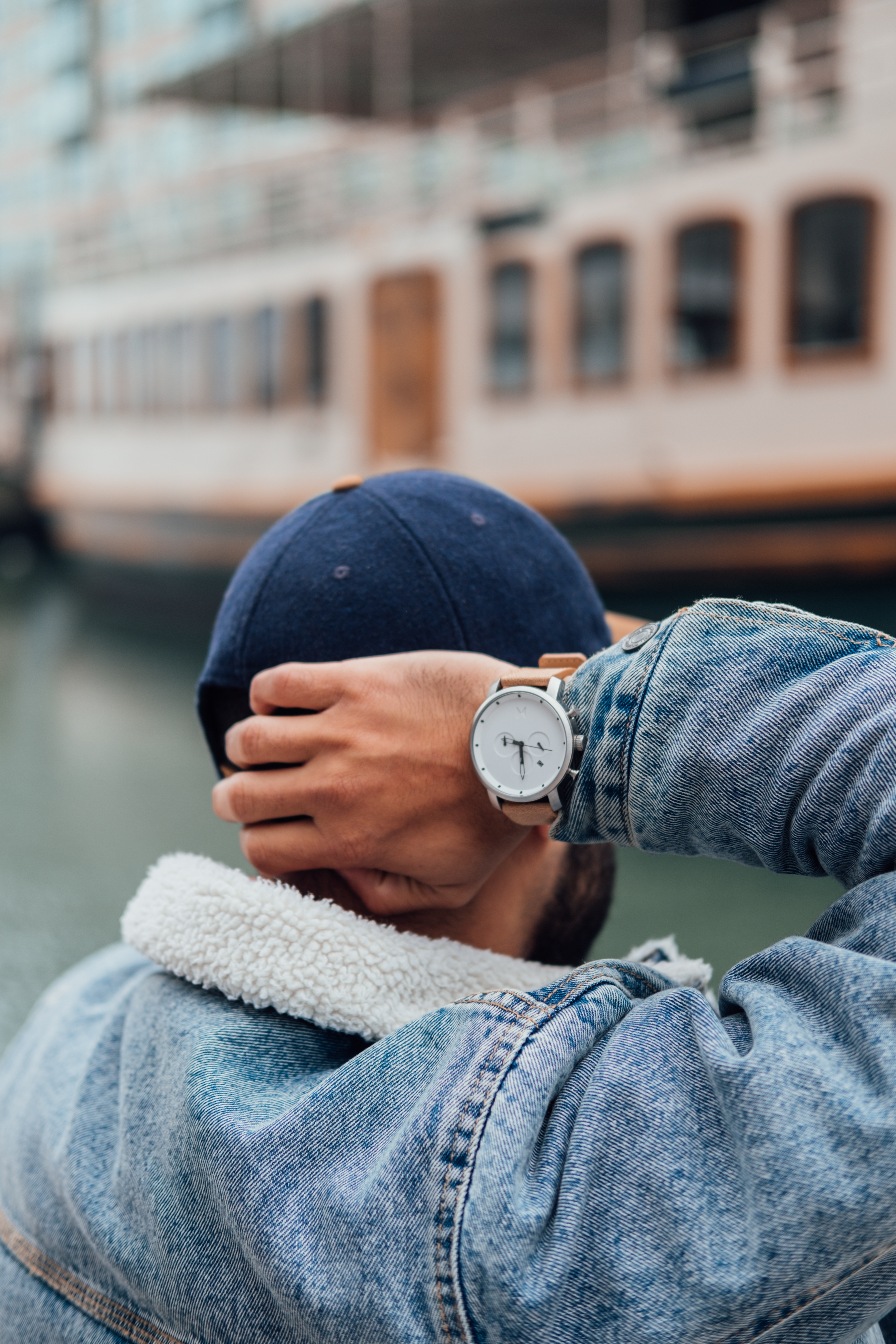 Person Wearing Blue Denim Jacket and Silver Round Analog Watch