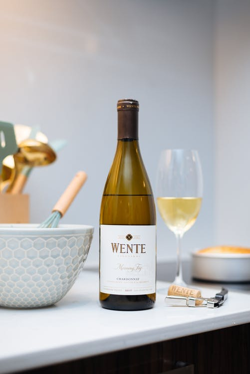 Wine Bottle Beside a Mixing Bowl and Wine Glass