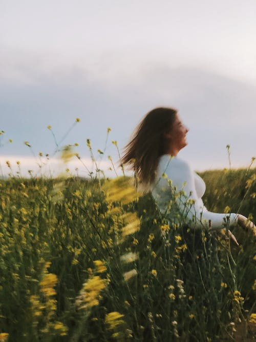 A Blur Shot On Woman in Green Grass