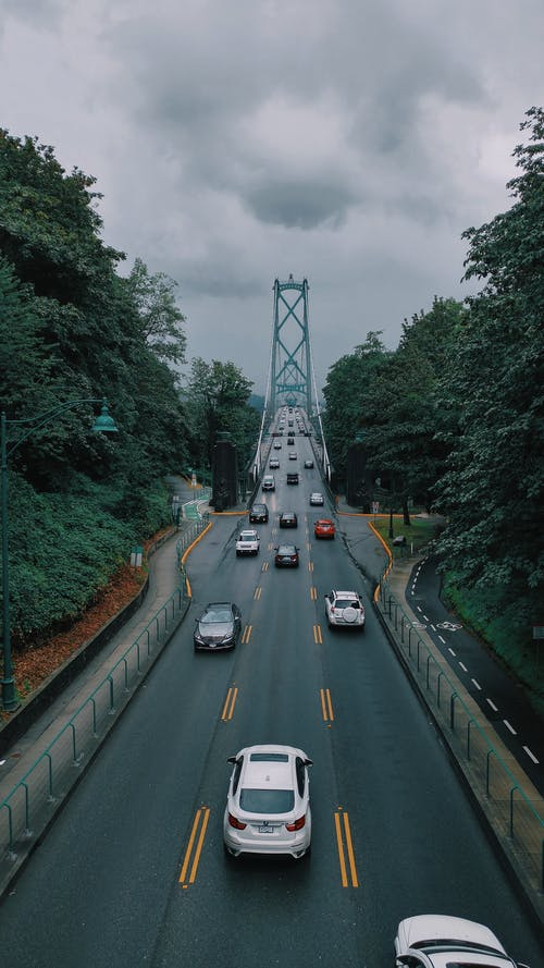 City roadway with cars in overcast