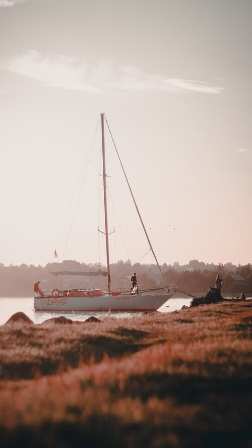 Photo Of Docked Boat During Dawn