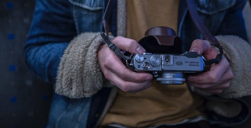Close-up Photography of Person Holding Camera