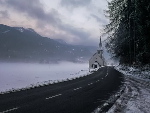 Free stock photo of church, slovenia, snowy