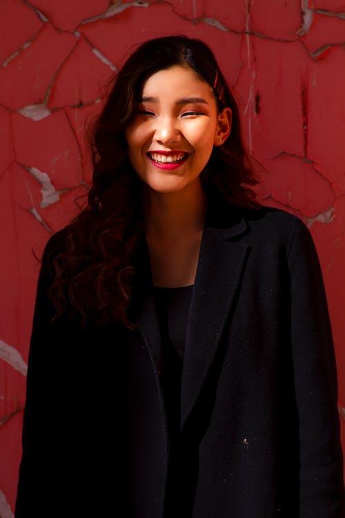 Woman Wearing Black Notched Lapel Coat
