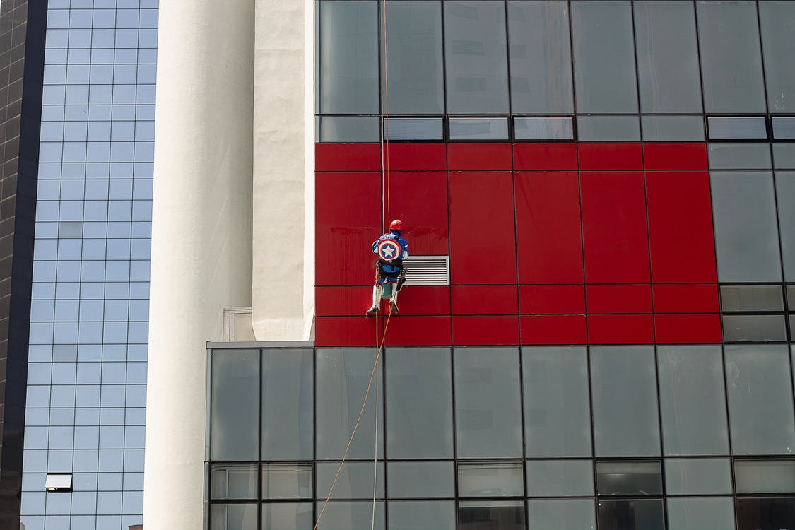 Photo Of Man Cleaning The Building During Daytime