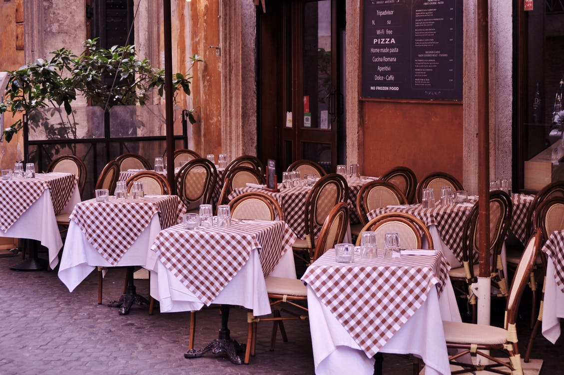 Empty Tables and Chairs in Restaurant by the Street