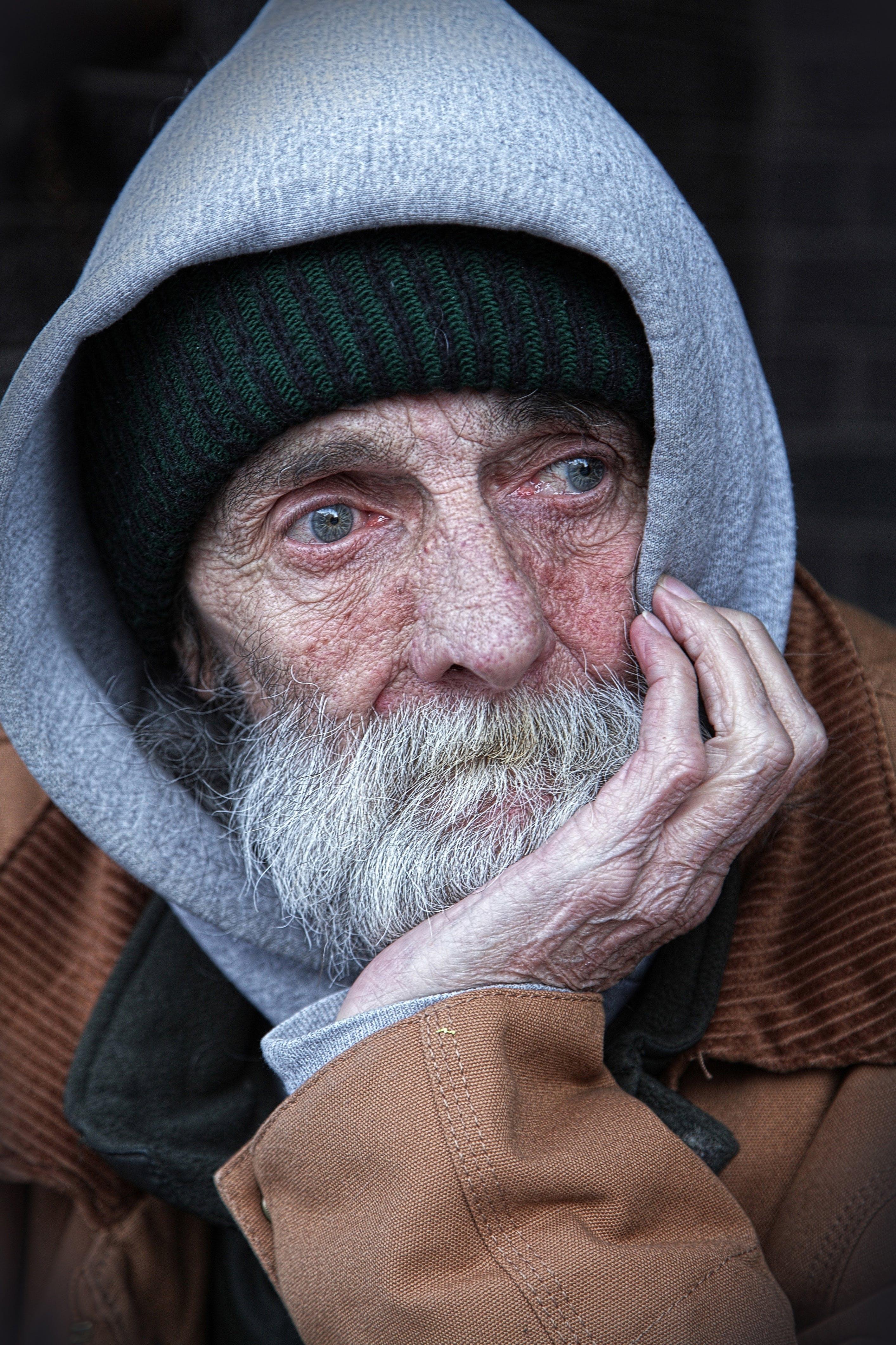 Man Wearing Brown and Gray Hoodie Jacket