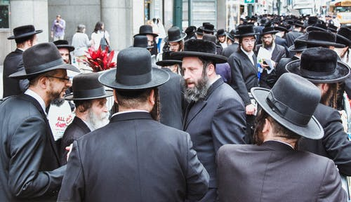 Man in Black Suit Jackets and Black Hats
