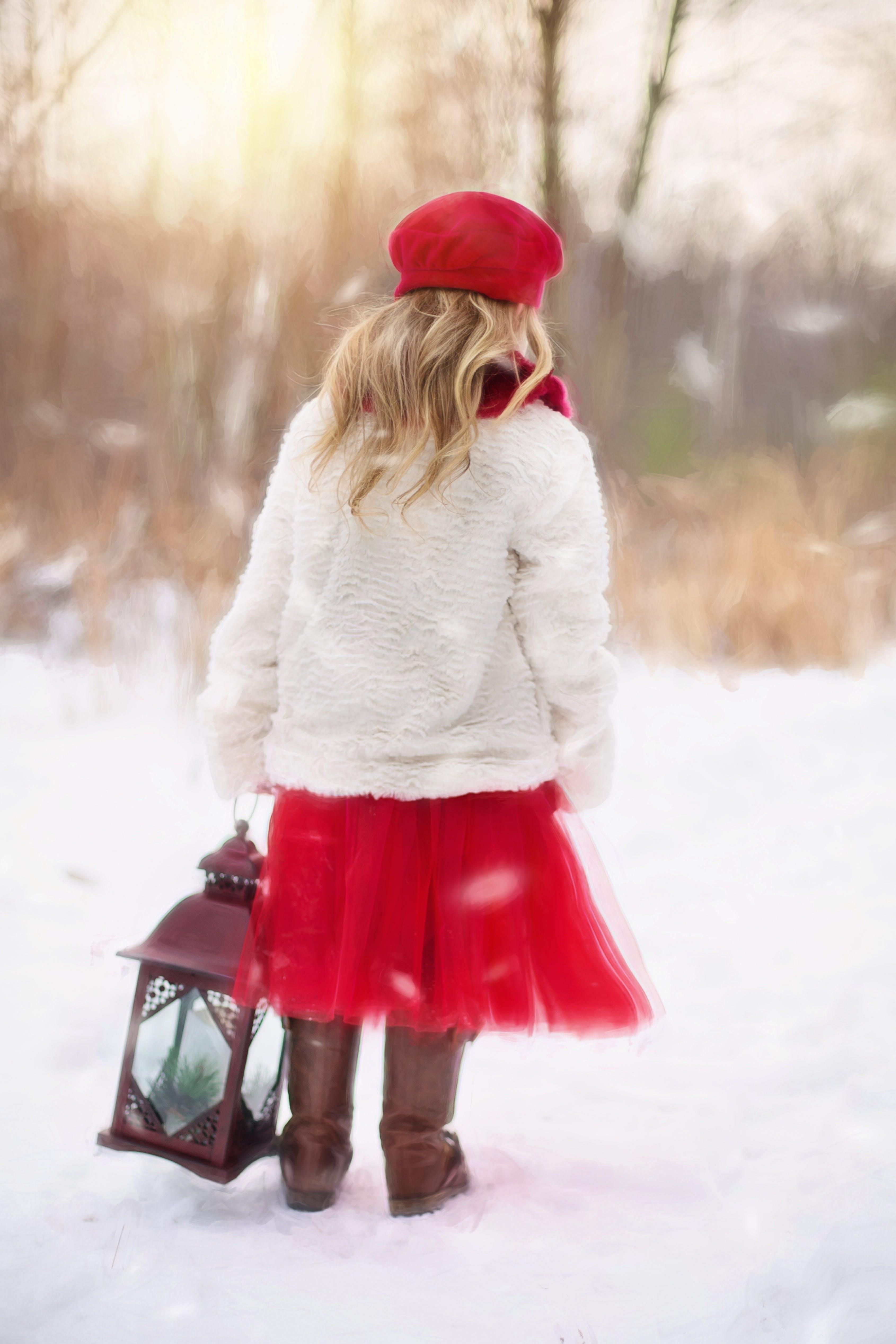 Woman Walking Holding Lantern