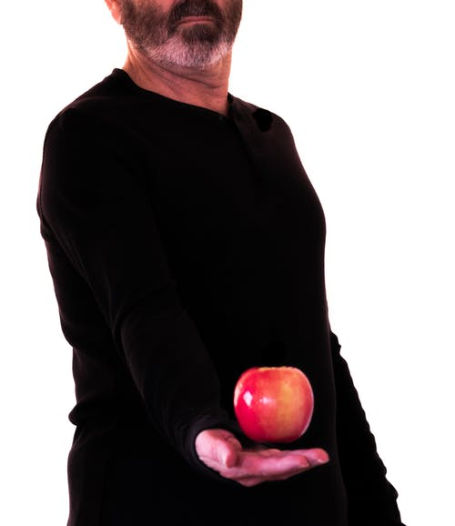 Free stock photo of bearded man, black shirt, color contrast, fruit