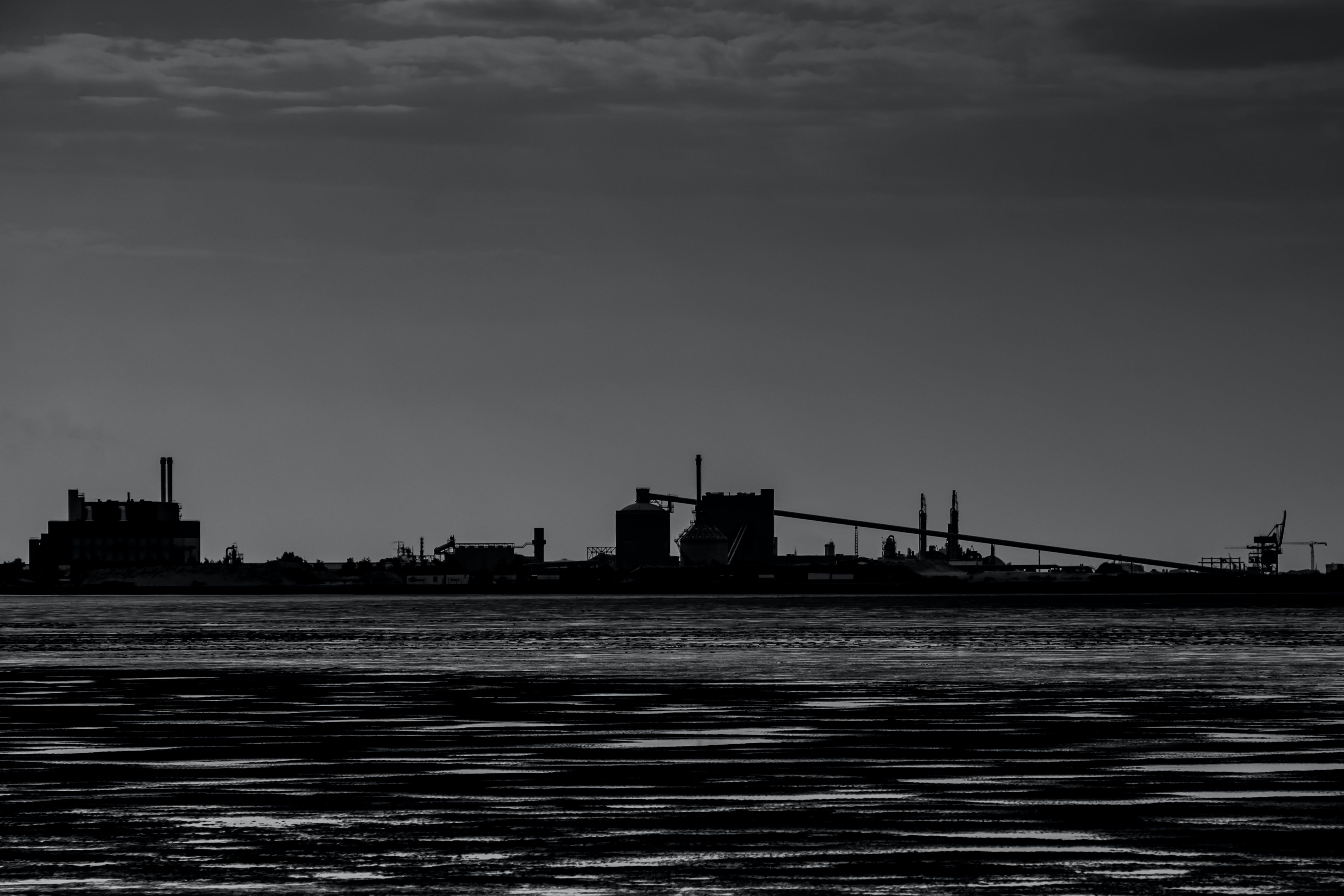 Silhouette Photo of Ship on Body of Water