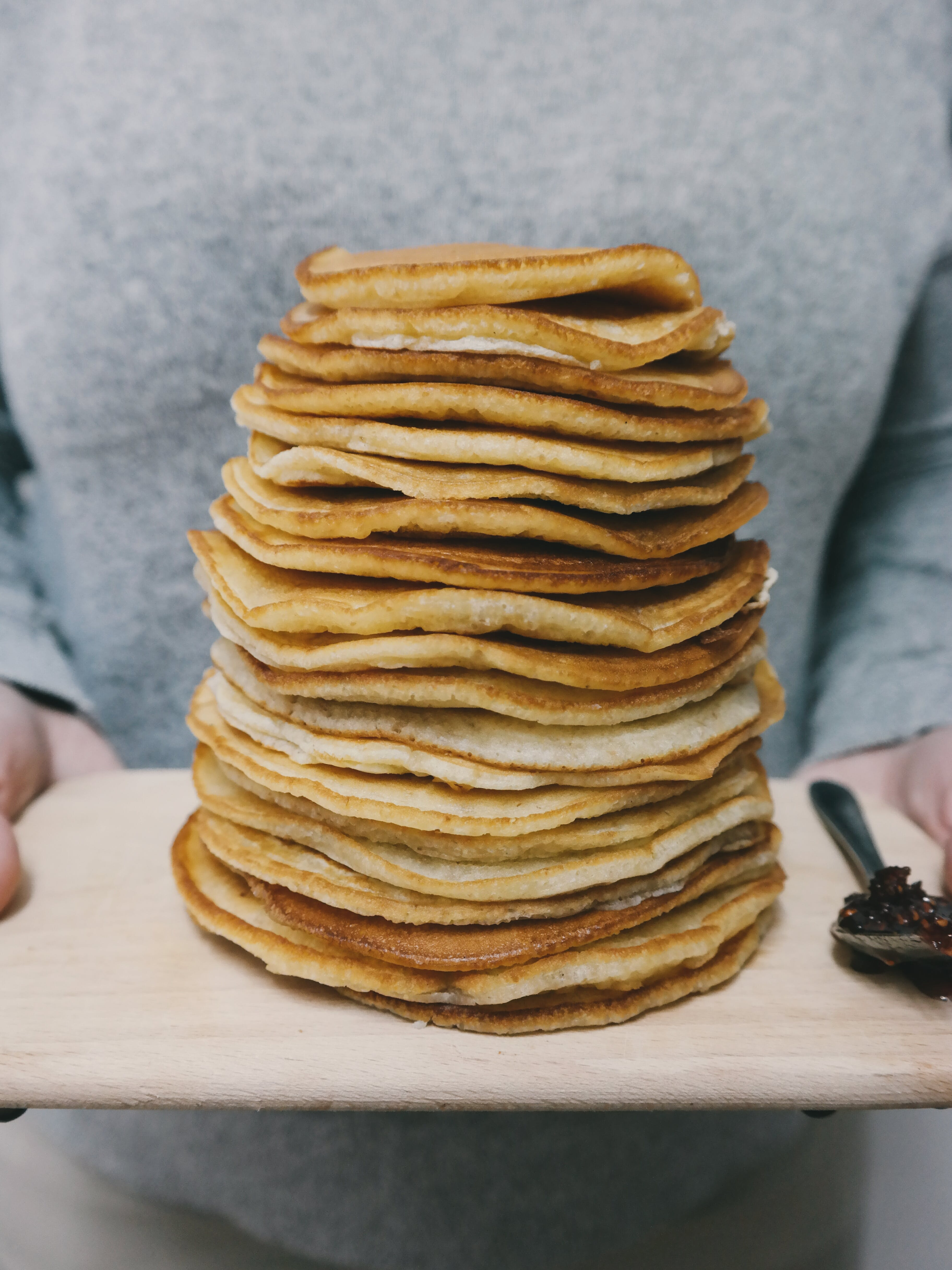 Person Holding Board With Pancakes