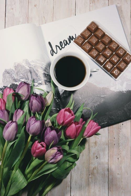 Bouquet of Tulips Near Coffee Mug