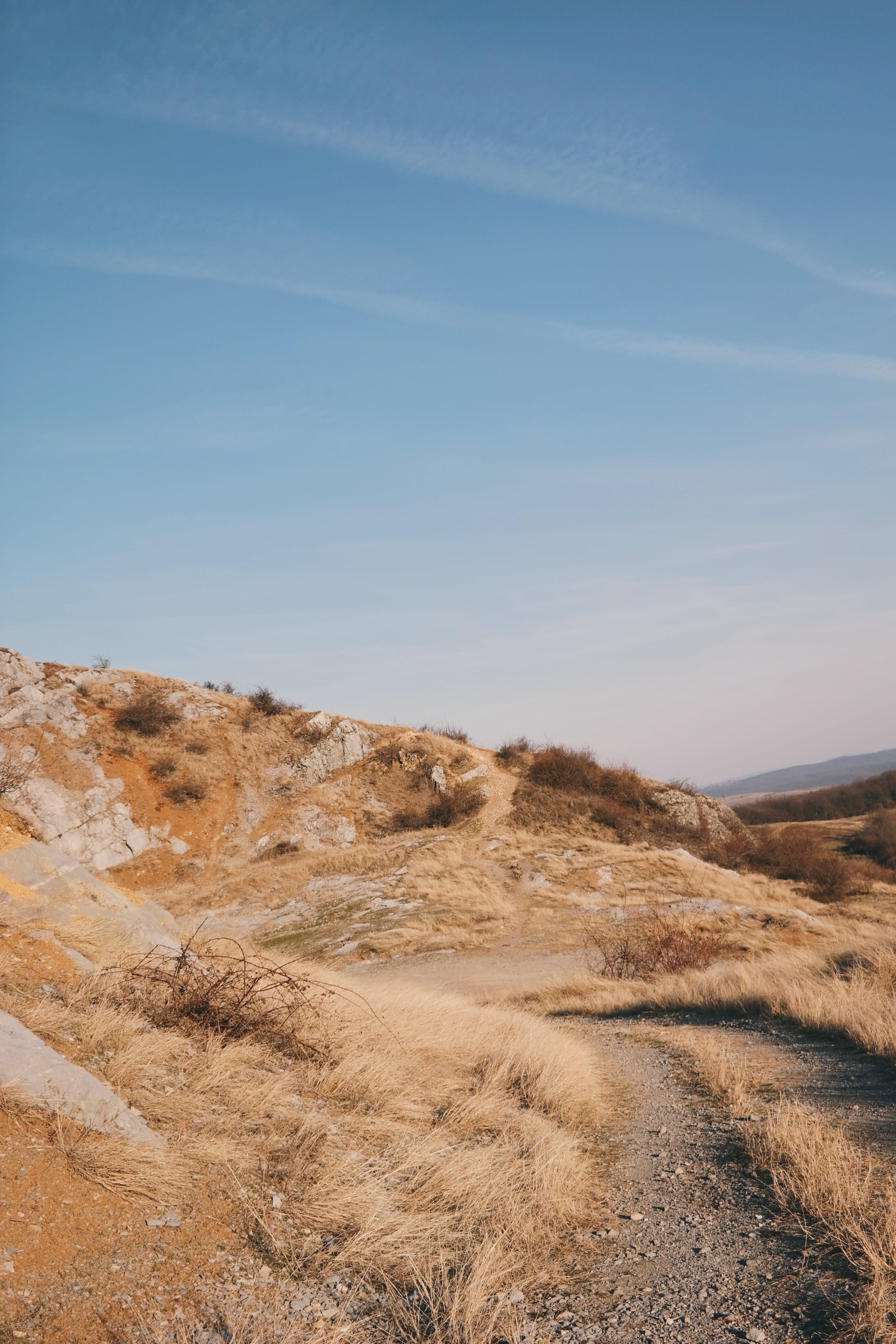 Kostenloses Stock Foto zu gras, himmel, sand, straße
