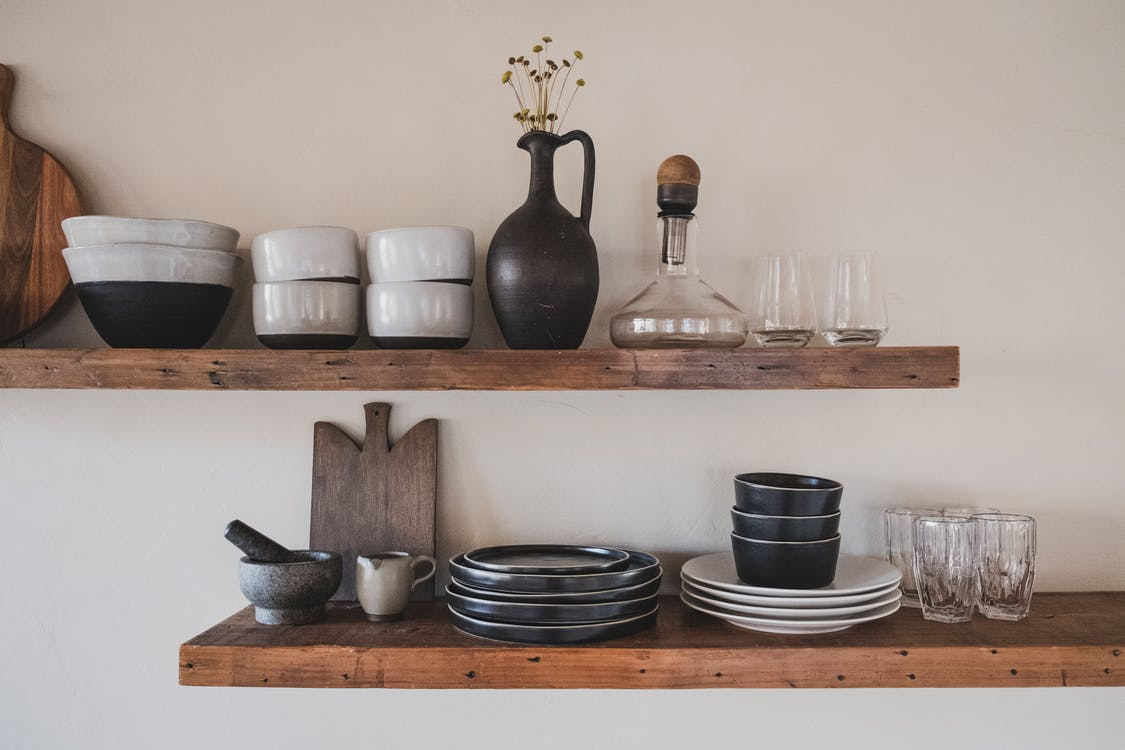 White Ceramic Bowls on Brown Wooden Shelf