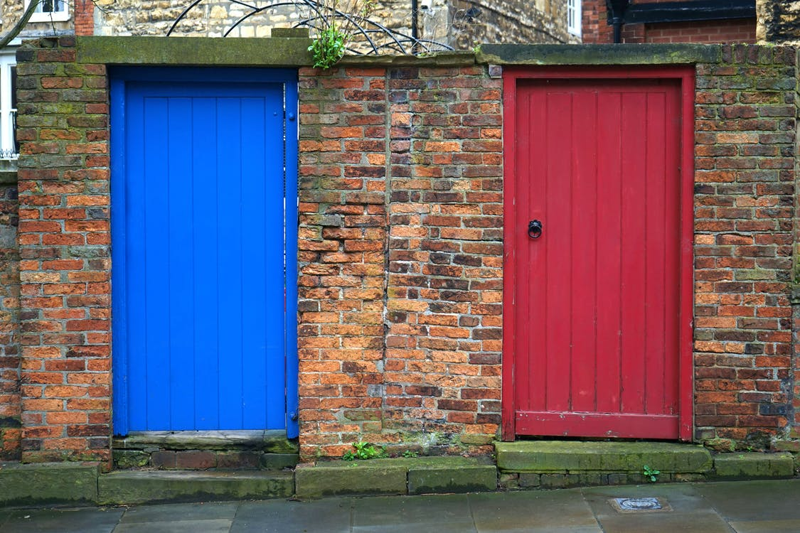 Closed Blue and Red Wooden Doors