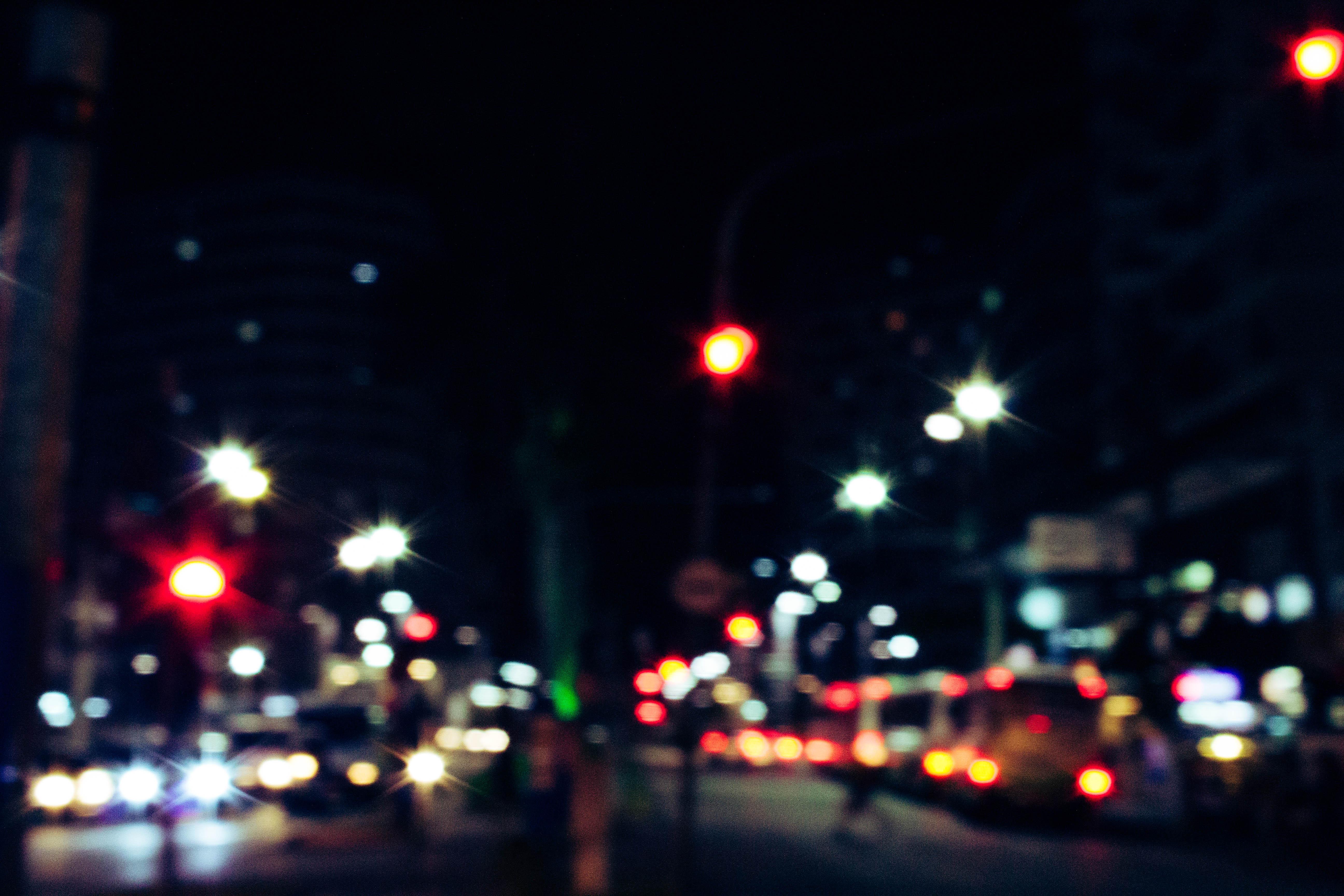 Bokeh Photography Of Street Full Of Vehicles At Night Free Stock Photo