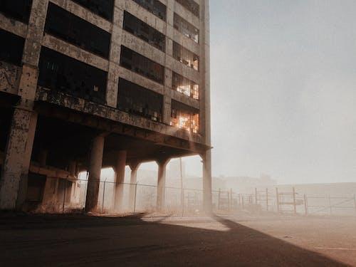 Abandoned Concrete Building Under White Sky