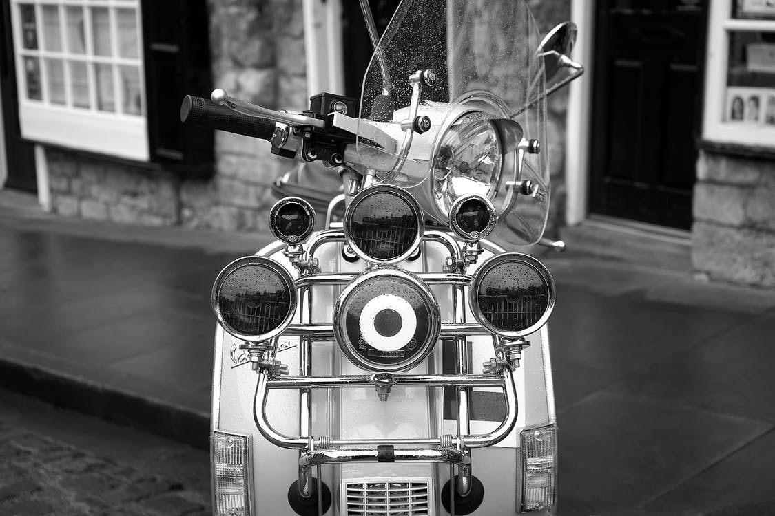 Grayscale Photo of Scooter Motorcycle