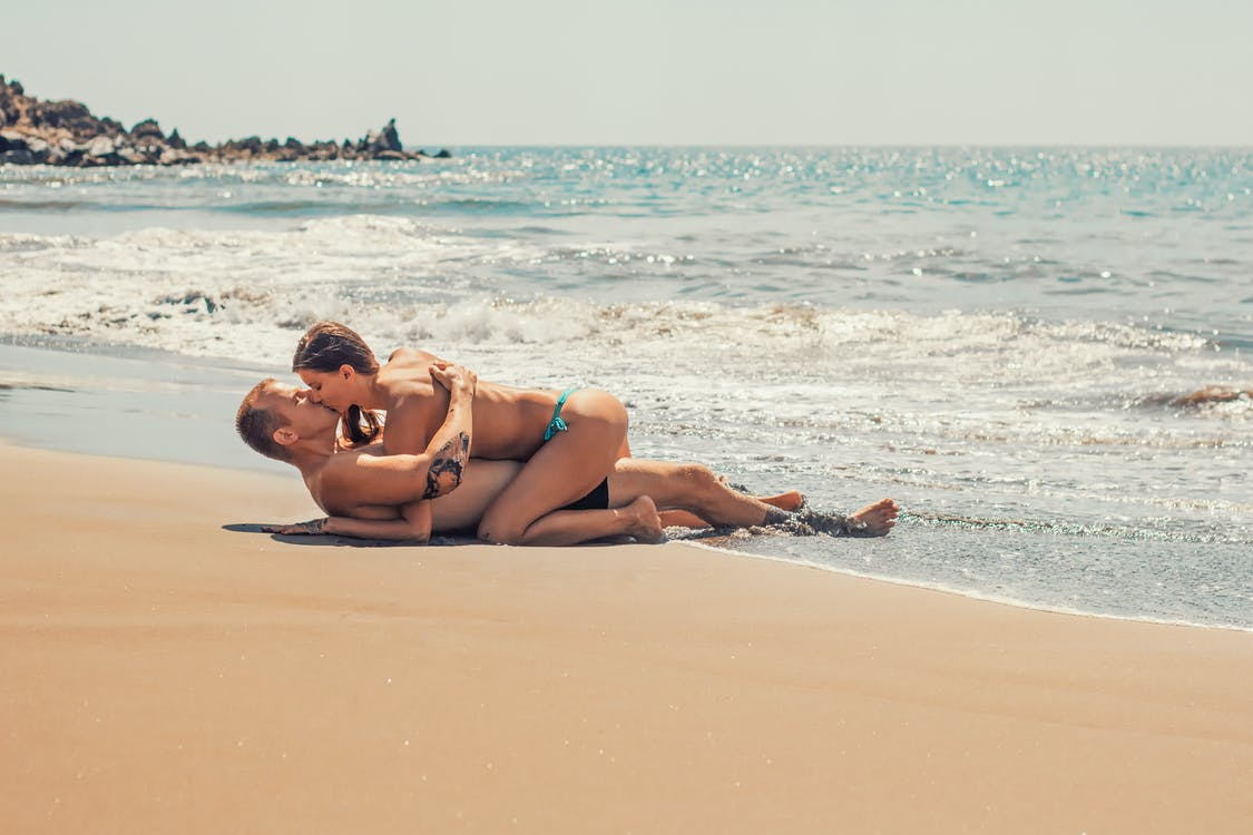 Man and Woman Kissing on Sea Shore