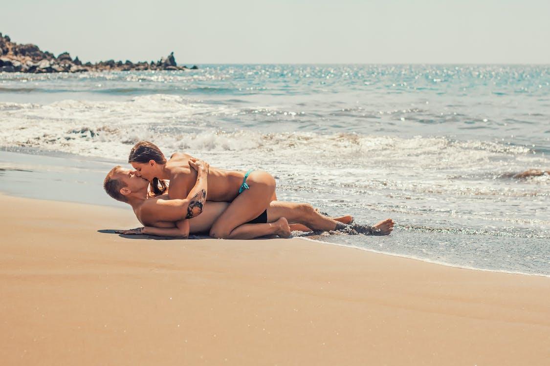 Man and Woman Kissing on Sea Shore