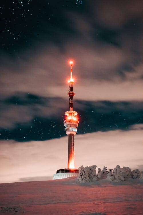 Red and White Tower Under A Starry Sky
