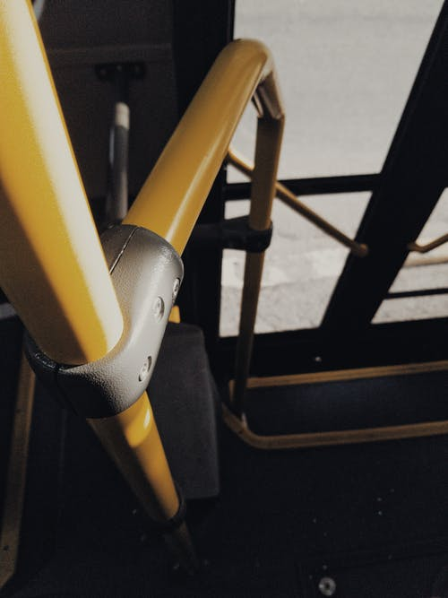 Yellow Handrail Of A Vehicle