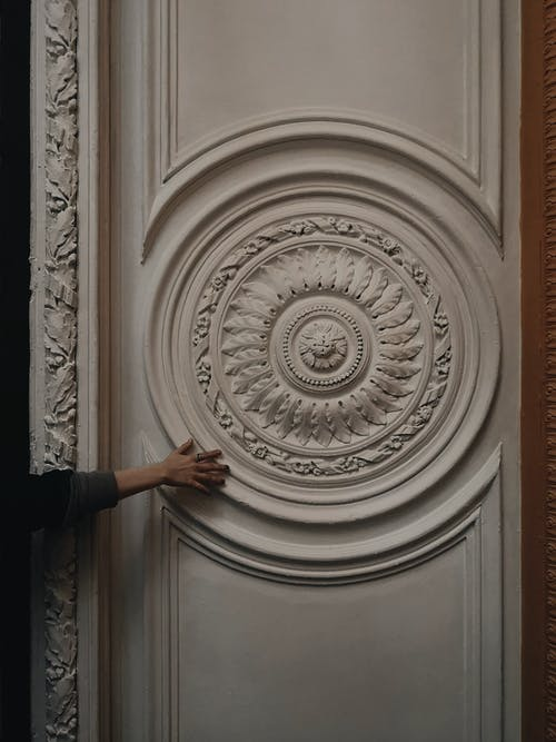 White Paneled Door With Carvings