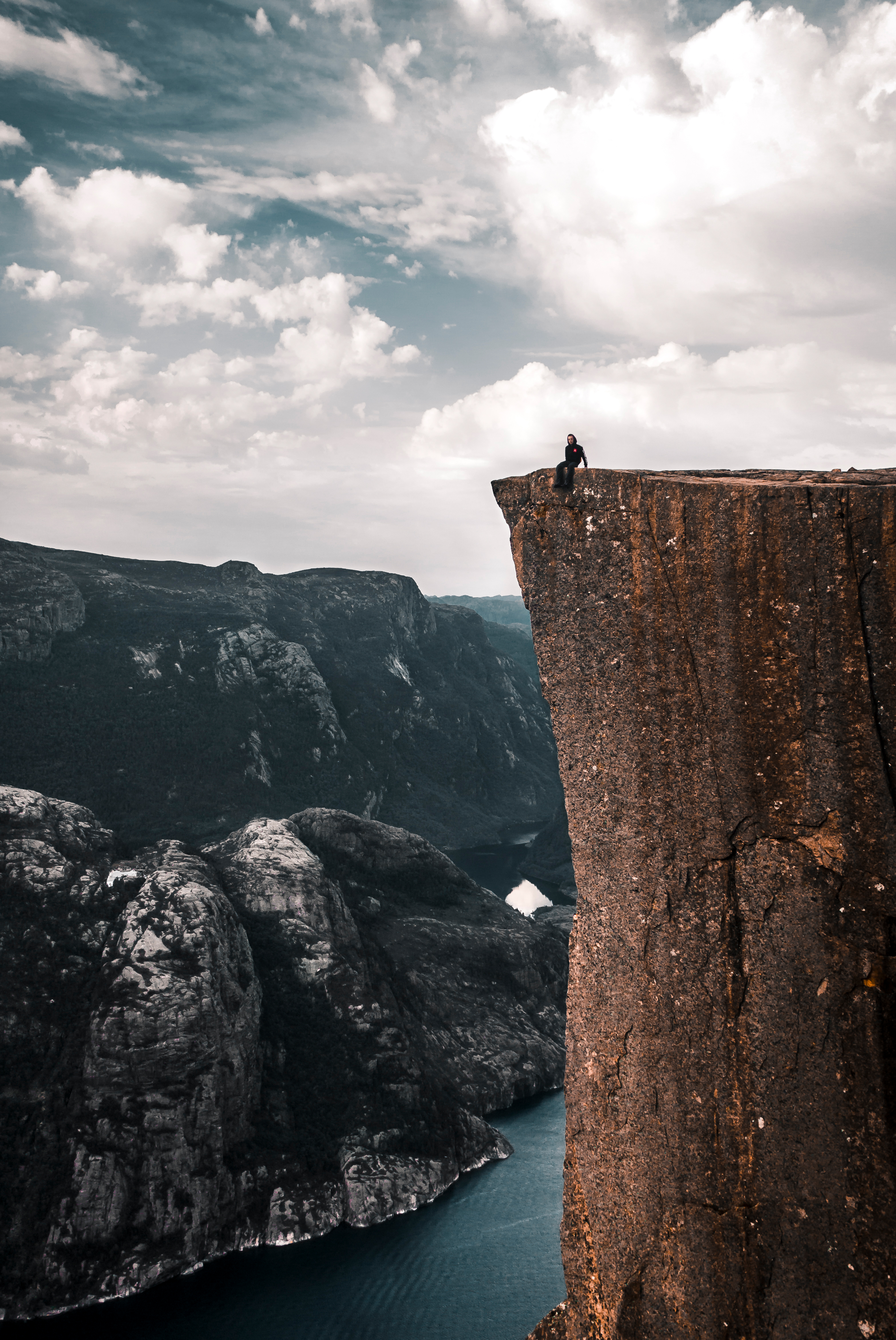 People Sitting on the Edge of a Cliff · Free Stock Photo