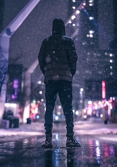 Person Standing Near Road  during Nighttime