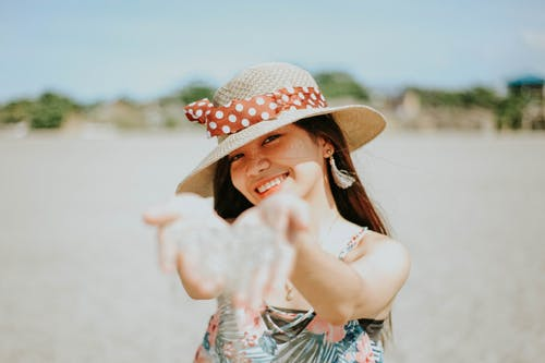 Woman in White and Blue Floral Dress Wearing Brown Straw Hat