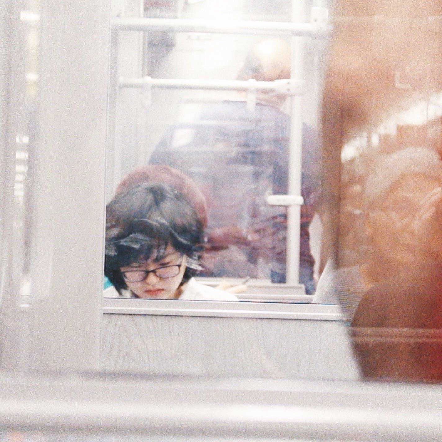 Woman Wearing Eyeglasses Reflection on Mirror