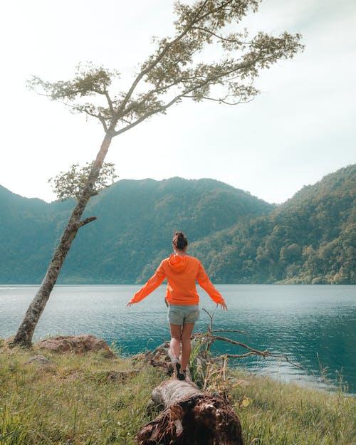 Free stock photo of adventure, camping, lakes, orange jacket