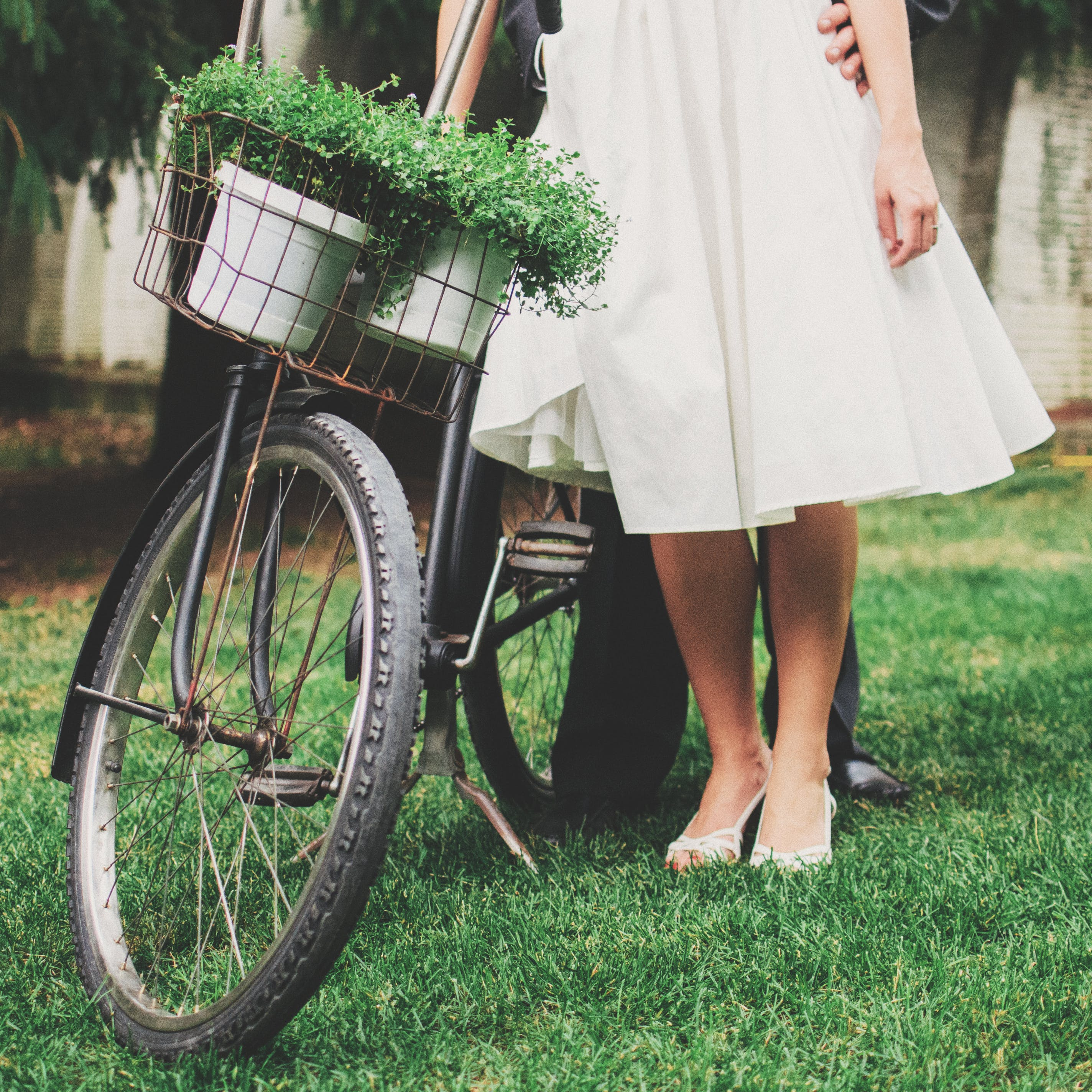 Woman and Man Standing Beside Bicycle