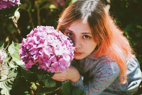 Girl Holding Purple Petaled Flower