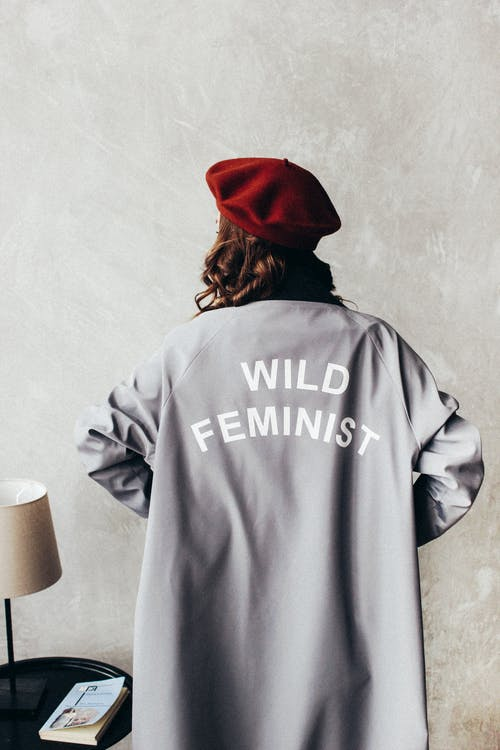 Woman Wearing Red Beret and Gray Long Sleeve Dress  with Wild Feminist Print
