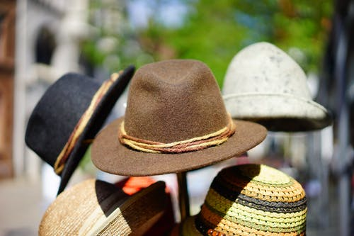Brown Fedora Hat in Selective Focus Photography