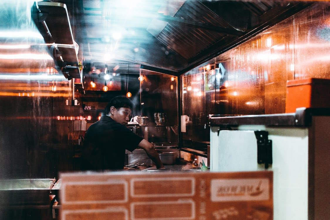 Man in Black Shirt Working in Kitchen