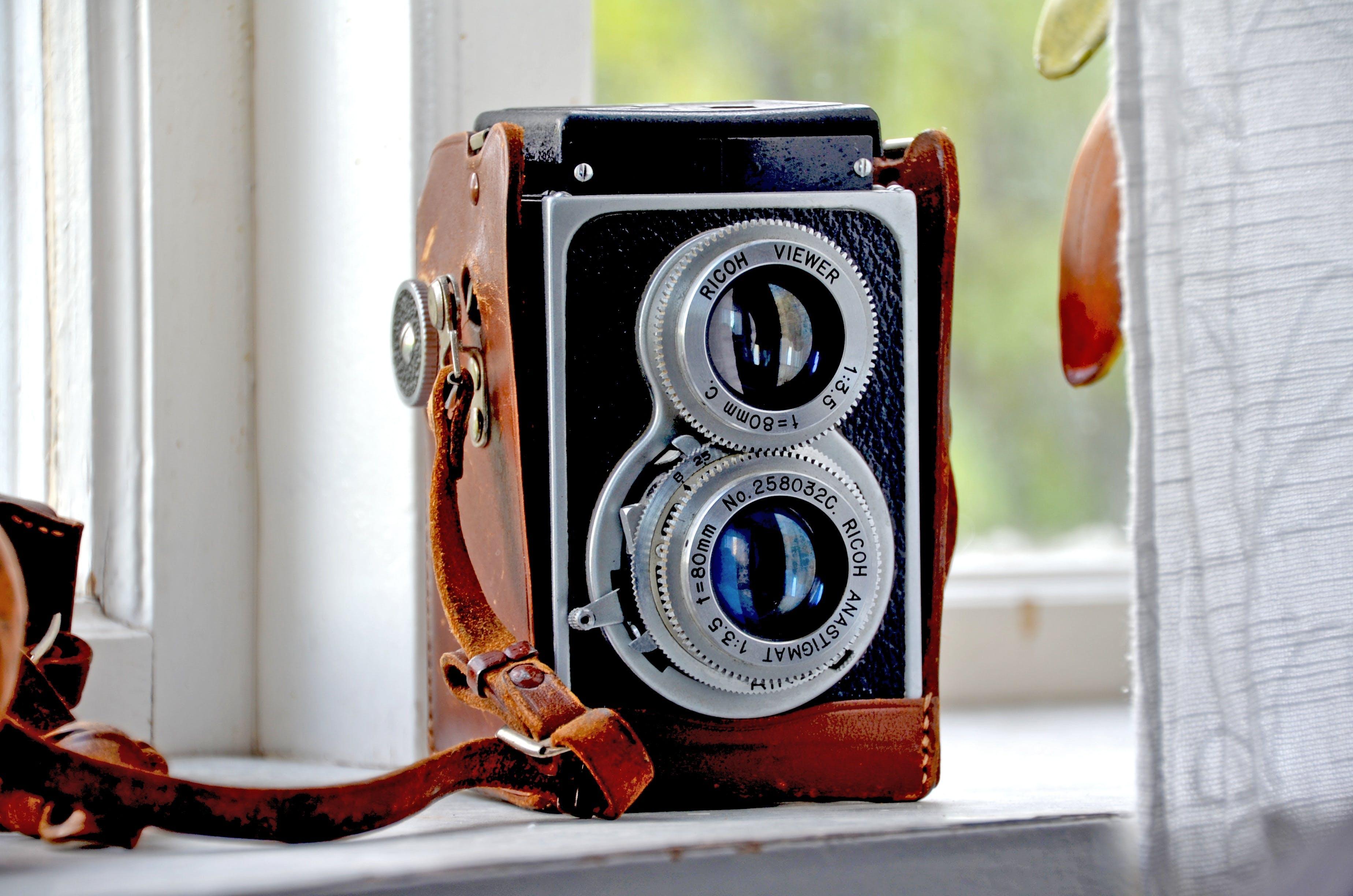 Brown, Black, and Silver Camera