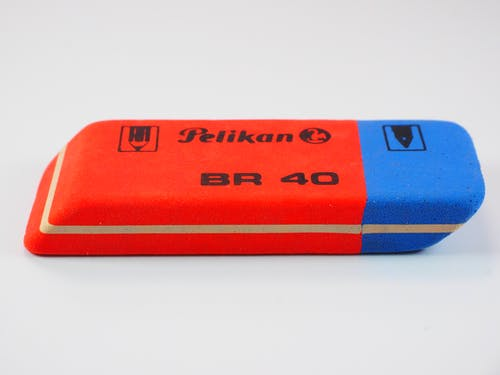 Red and Blue Pelikan Br 40 Eraser on White Surface