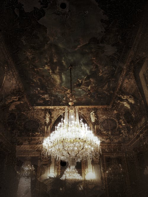 Glass Chandelier on Brown Ceiling
