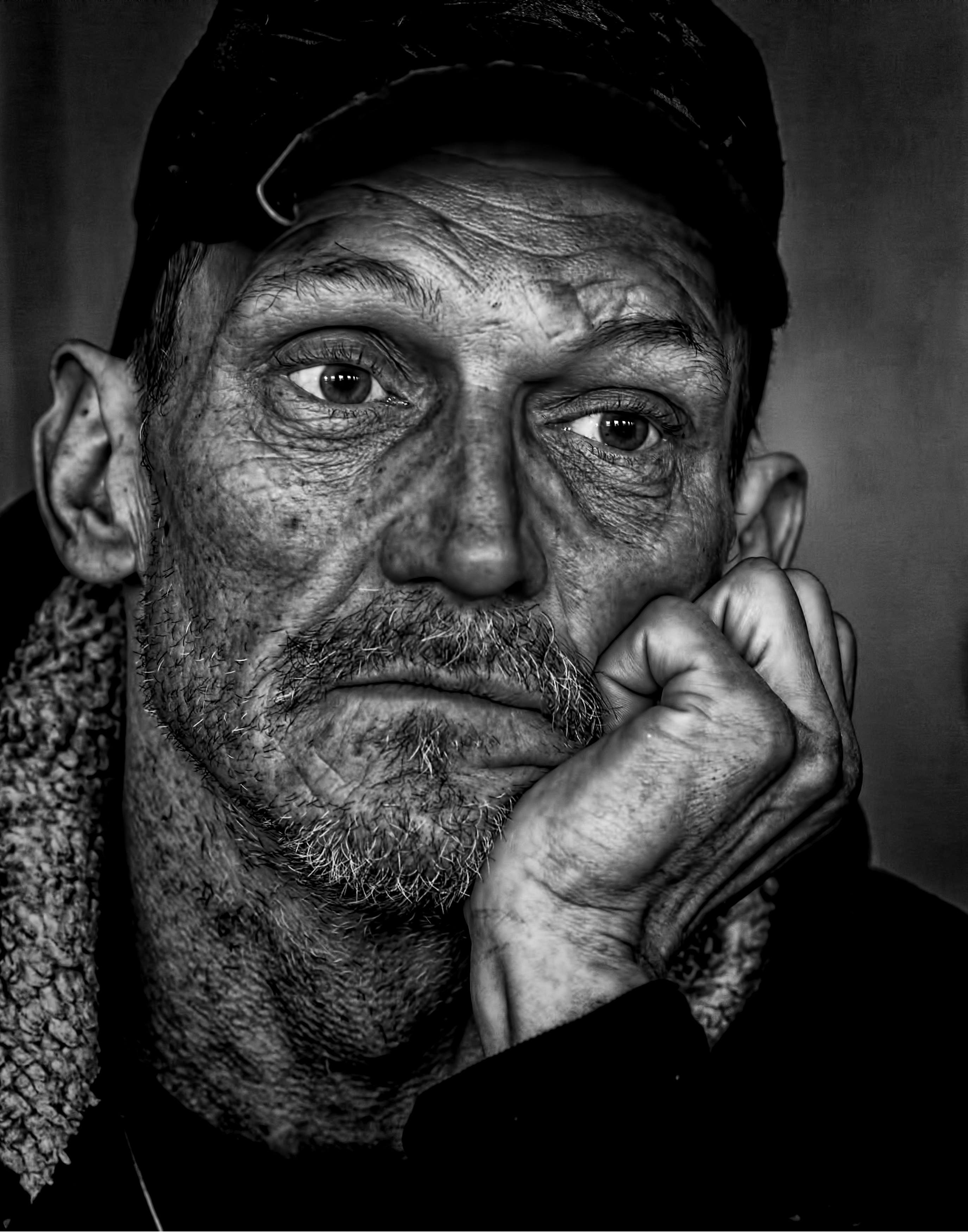 Man in Black Cap Grayscale Photo