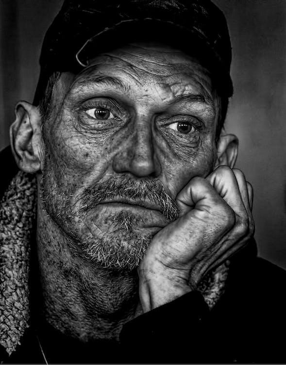 Man in Black Cap Grayscale Photo