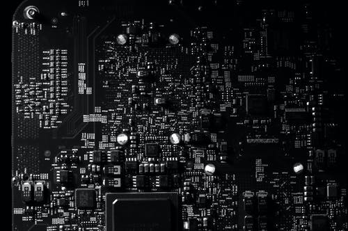 Black and White Photography of a Mother Board