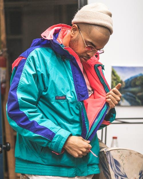 Photo of Man Wearing Colorful Jacket