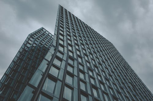 Low-angle Photography of Curtain Wall High-rise Building Under Cloudy Sky