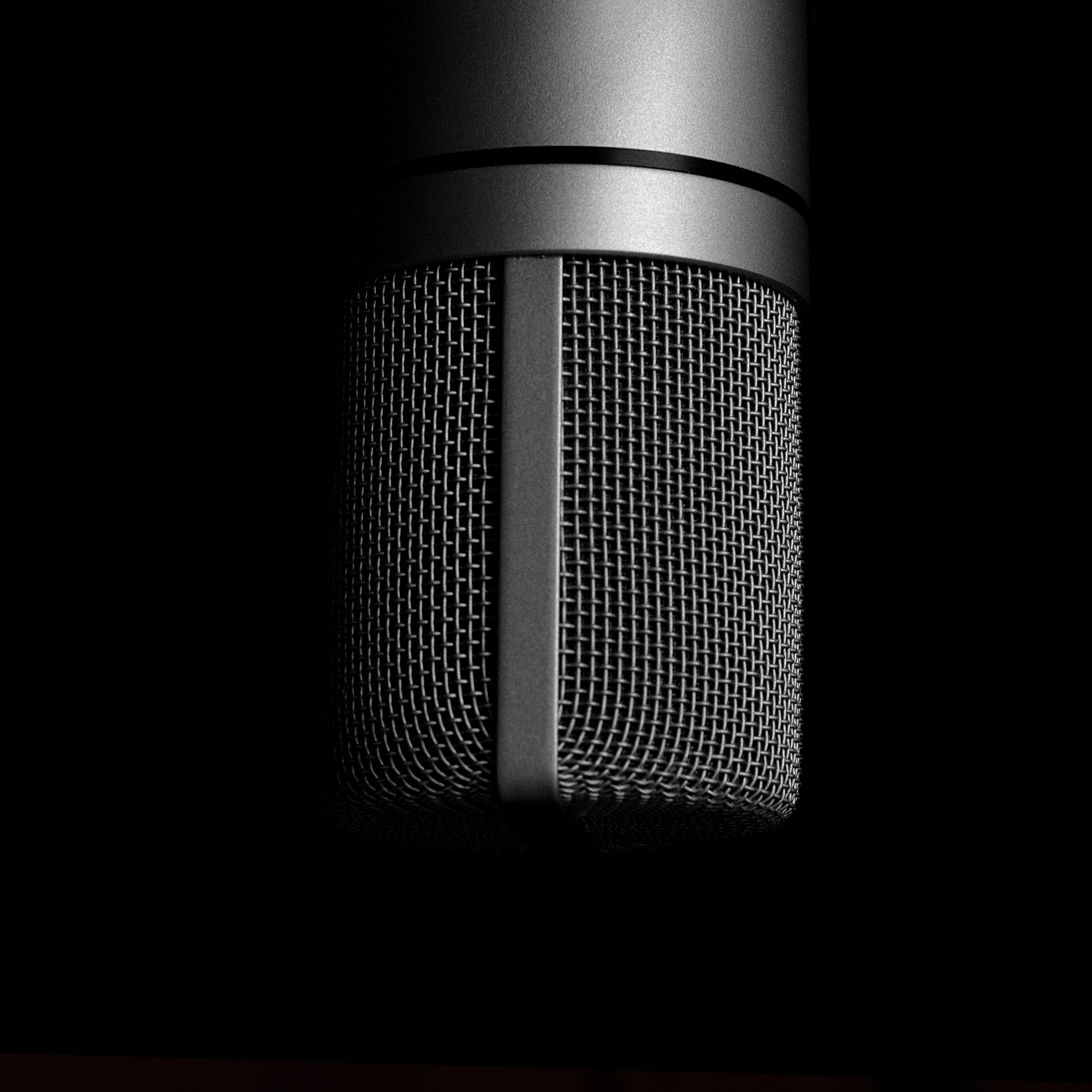 Black Headset Hanging On Black And Gray Microphone · Free