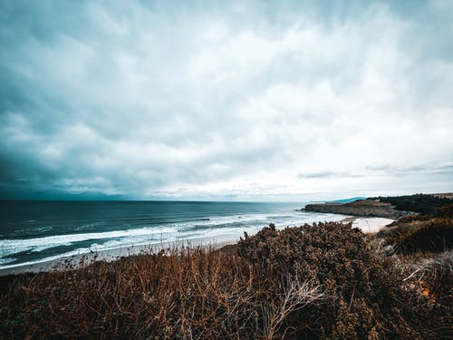 Free stock photo of beach, cliff, cloudy skies