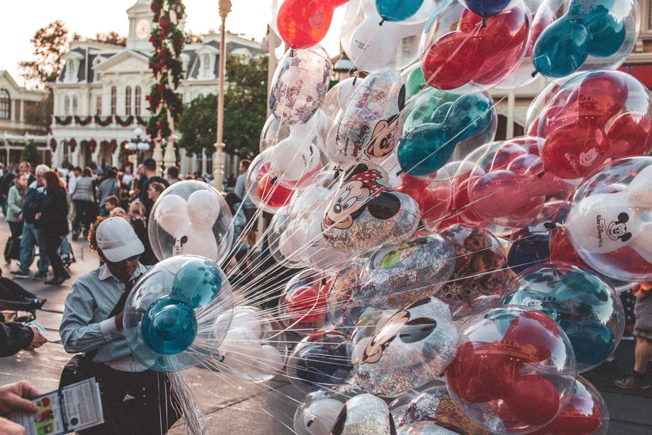 Photo of person holding balloons
